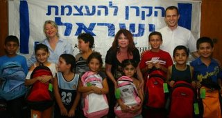 Israeli children receiving new backpacks paid for by The Joshua Fund in September 2008
