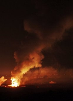 Fires are raging in Gaza as Israeli bombs pound Hamas missile launchers and weapons depots
