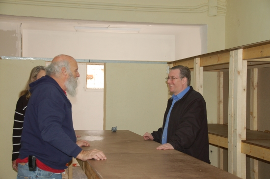 Joel meets with several Sderot residents in the new food distribution facility
