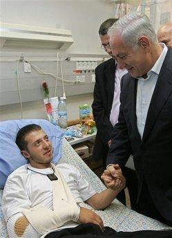 Netanyahu meeting with an Israeli civilian victim of a Hamas rocket attack in Ashkelon