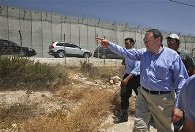 Huckabee also toured the security fence separating the West Bank from the rest of Israel.