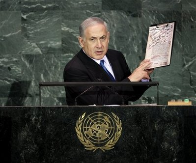 Benjamin Netanyahu, prime minister of Israel, holds up Nazi documents during his speech at the 64th session of the General Assembly at United Nations headquarters, Thursday, Sept. 24, 2009. (AP Photo)