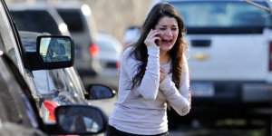 Grieving at the Sandy Hook Elementary School in Newtown, CT (photo credit: AP)