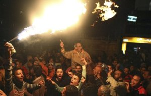 Protesters opposing Egyptian President Mohamed Mursi march despite a nighttime curfew in the city of Suez January 28, 2013. (photo credit: Reuters)