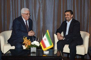 Abbas and Ahmadinejad talk during Organisation of Islamic Cooperation summit in Cairo. Photo by AFP