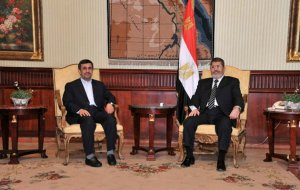 Iran's President Mahmoud Ahmadinejad, left, and Egyptian President Mohammed Morsi, right, pose for photographers in Cairo, Egypt, Tuesday, Feb. 5, 2013. (AP Photo/Egyptian Presidency)