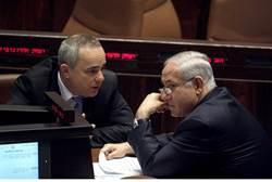 Israeli Intelligence Minister Yuval Steinitz (left) confers with Prime Minister Netanyahu.