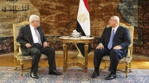 Palestinian President Mahmoud Abbas meets Egyptian interim President Adly Mansour at the Presidential Palace in Cairo, Egypt, on Monday, July 29, 2013. (photo credit: AP/Mohammed Samah, Egyptian Presidency/Times of Israel)