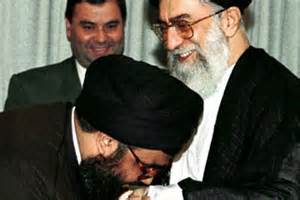 Hezbollah leader Sheikh Hassan Nasrallah kissing the hand of Iranian Supreme Leader Khamenei. Together, they are plotting a takeover of Syria says a new Israeli report.