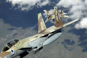 Illustrative photo of two Israeli F-15I 'Ra'am' fighter jets during maneuvers (photo credit: CC BY-TSgt Kevin J. Gruenwald/USA/Wikimedia/Times of Israel)
