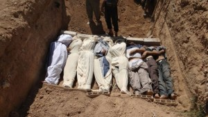 Bodies being buried after the chemical attack in Damascus last week. (photo credit: AP/Shaam News Network)
