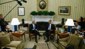 Israeli PM Netanyahu (left) and President Obama speak to the Press in the Oval Office. (photo credit: AP)