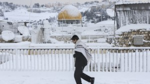 The Dome of the Rock is seen in the background in Jerusalem's Old on a snowy winter day on Friday, December 13, 2013. (Photo credit: Nati Shohat/Flash90/Times of Israel)