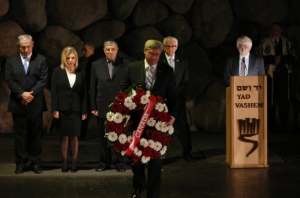 Canadian PM Stephen Harper lays a wreath at Yad Vashem to honor the 6 million Jews murdered in the Holocaust.