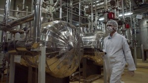 An Iranian worker at the Uranium Conversion Facility at Isfahan, 410 kilometers, south of Tehran. The conversion facility in Isfahan reprocesses uranium ore concentrate, known as yellowcake, into uranium hexaflouride gas. The gas is then taken to Natanz and fed into the centrifuges for enrichment. (photo credit: AP Photo/Vahid Salemi/Times of Israel)