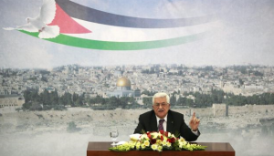 Palestinian President Mahmoud Abbas speaks during a meeting at his compound in the West Bank city of Ramallah, Saturday, Jan. 11, 2014. (Photo by AP)
