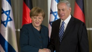 German Chancellor Angela Merkel shakes hands with Prime Minister Benjamin Netanyahu after arriving in Jerusalem on Monday, February 24, 2014. (photo credit: Sebastian Scheiner/AFP/Times of Israel.)