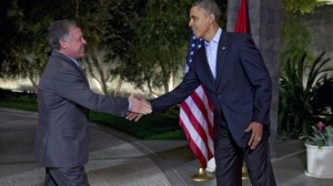 President Barack Obama greets Jordan's King Abdullah II at The Annenberg Retreat at Sunnylands, Rancho Mirage, Calif., Friday, Feb. 14, 2014. (photo credit: AP Photo/Jacquelyn Martin/Times of Israel)