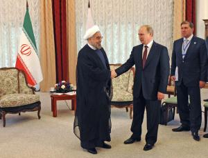 Russia's President Vladimir Putin (2nd L) shakes hands with his Iranian counterpart Hassan Rouhani (L) during a meeting at the Shanghai Cooperation Organization (SCO) summit in Bishkek, September 13, 2013. (REUTERS/Mikhail Klimentyev/RIA Novosti/Kremlin)