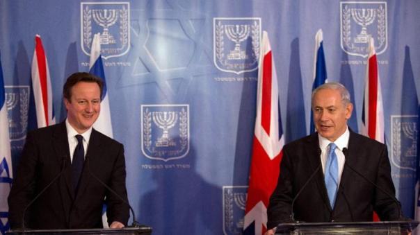 Israeli Prime Minister Benjamin Netanyahu, right, and his British counterpart David Cameron attend a joint press conference in Jerusalem on Wednesday, March 12, 2014, following their meeting. (photo credit: AP)