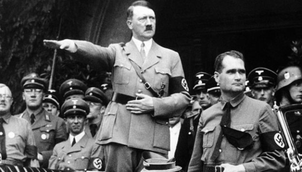 German Chancellor Adolf Hitler and his personal representative Rudolf Hess, right, during a parade in Berlin, Germany, on Dec. 30, 1938. (Photo by AP/Haaretz)