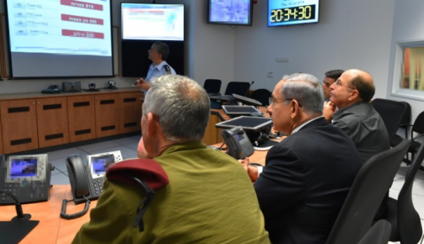IDF chief of staff Benny Gantz (left), PM Netanyahu (center), and Defense Minister Moshe Yaalon (right) are assessing what Hamas is trying to accomplish, and whether an IDF invasion of Gaza is the only way forward.