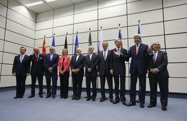 Delegates from Iran and a group of six nations led by the United States in Vienna on Tuesday after reaching an accord.   Credit Carlos Barria/Agence France-Presse — Getty Images  (NYT)
